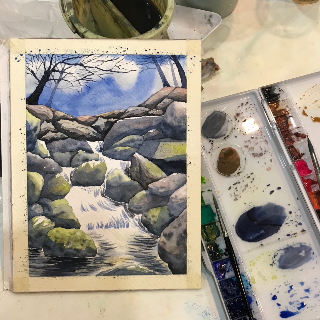 Stream and rocks in watercolor